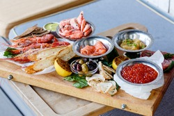 assortment of fish delicacy on wood plate