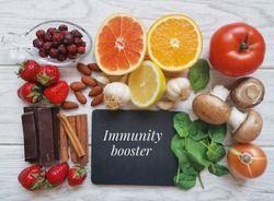Assortment of food to naturally boost immune system. Healthy eating for strong immune system. Immune-boosting foods. Concept of helpful ways to strengthen immunity naturally.