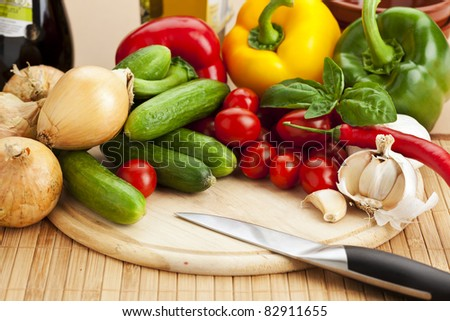 assortment of fresh vegetables on cutting board