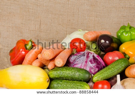 Assortment of fresh vegetables on on sacking background