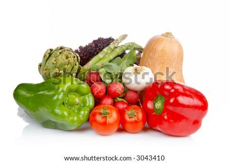 Assortment of fresh vegetables reflected on white background