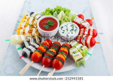 Assortment of fruit and vegetable appetizer with dips
