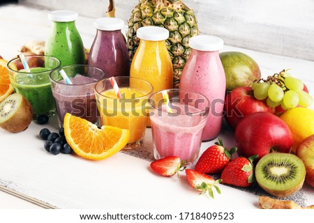 Assortment of fruit smoothies in glass bottles. Fresh organic Smoothie ingredients. Smoothies for health or detox diet food concept. Stock foto ©