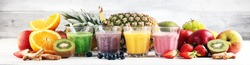 Assortment of fruit smoothies in glasses. Fresh organic Smoothie ingredients. Smoothies for health or detox diet food concept.