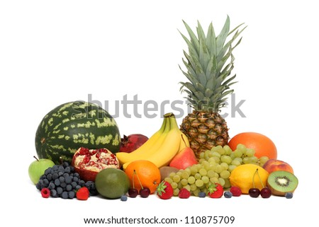 Assortment of fruits and berries isolated on white background