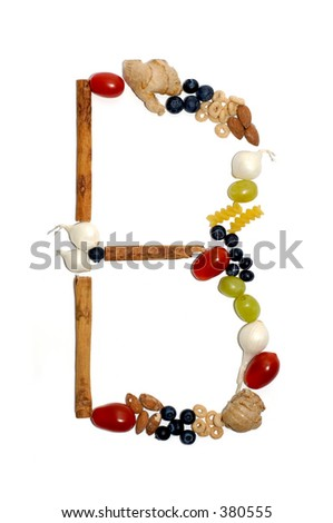 Assortment of fruits forming the letter 'B'. White background.