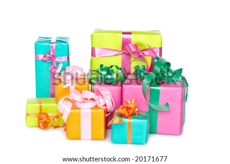 Assortment of gift boxes, reflected on white background. Shallow depth of field