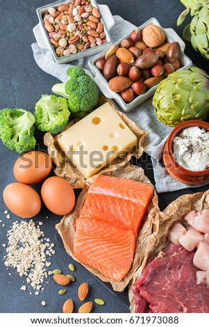 Assortment of healthy protein source and body building food. Meat beef salmon chicken breast eggs dairy products cheese yogurt beans artichokes broccoli nuts oat meal. Top view flat lay #671973088