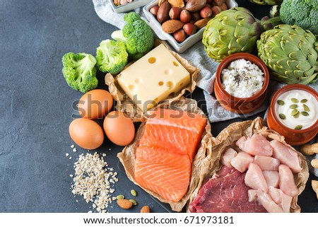 Assortment of healthy protein source and body building food. Meat beef salmon chicken breast eggs dairy products cheese yogurt beans artichokes broccoli nuts oat meal. Top view flat lay #671973181