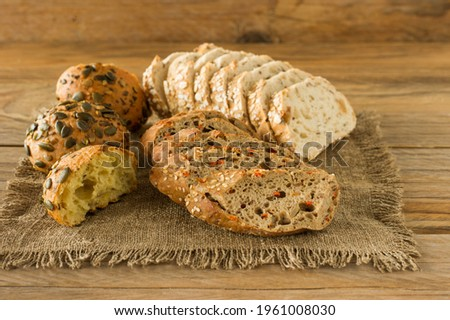 Assortment of Homemade Gluten-free vegan bread on the rustic wooden table. Homemade baked pastry.