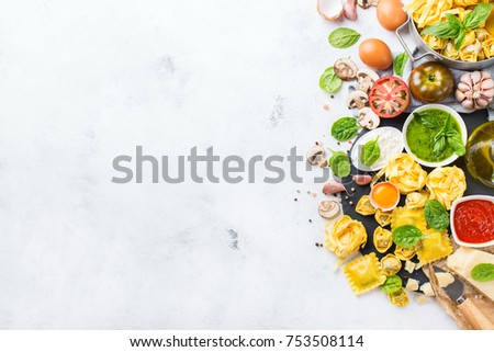 Shutterstock Assortment of italian food and ingredients, ravioli with ricotta and spinach pasta tortellini pesto tomato sauce olive oil parmesan cheese. Top view flat lay copy space background
