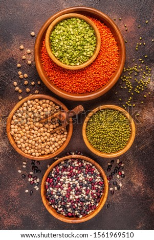 Assortment  of Legumes - lentils, peas, mung, chickpeas and different beans. Top view.