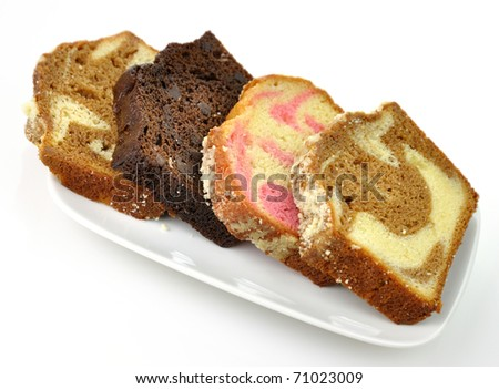assortment of loaf cake slices , double chocolate ,raspberry swirl and ...