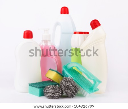 Assortment of means for cleaning on white - stock photo