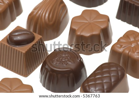 Assortment of milk and dark chocolates isolated on white background