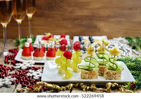 Assortment of New Year\'s snacks and a glass of champagne. toning. selective focus
