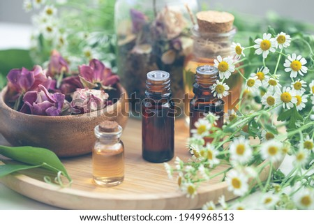 Assortment of organic essential oils. Natural moisturizing body and face treatment. Rose, camomile extract for healthy young skin. Relaxation, aromatherapy, salon spa. Close up, macro view Foto stock ©