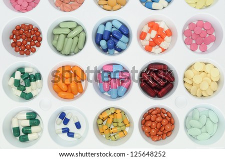 Assortment of pills and capsules of colours. Medication varied sampler, pills, tablets and drugs