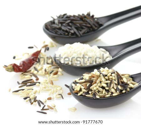 Assortment Of Rice In The Black Spoons