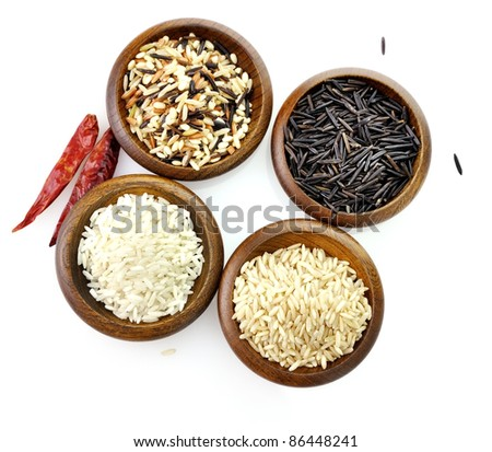 assortment of rice in wooden bowls on white background