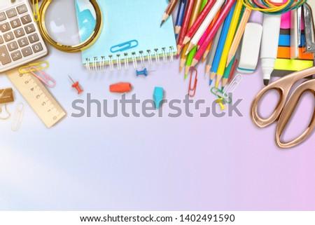Assortment  of School supplies on  background #1402491590