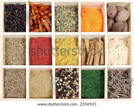 Assortment of spices for prepare tasty food on wooden box.