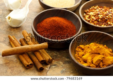 Assortment of spices in wooden bowls