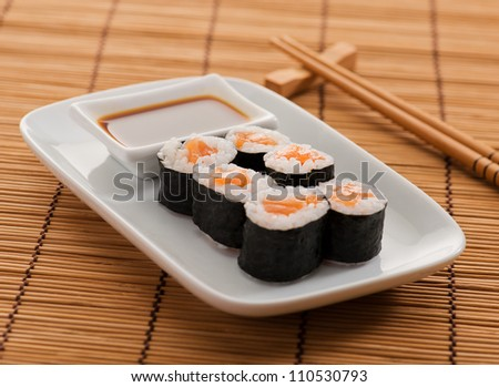 Assortment Of Sushi Rolls Placed On Wooden Mat
