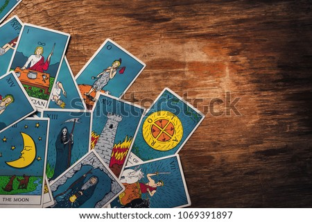 Fortune teller forecasting the future with tarot cards on
