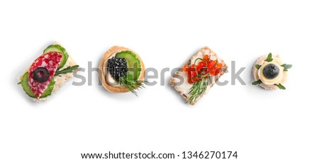 Assortment of tasty canapes on white background Photo stock ©