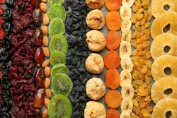 Assortment of tasty dried fruits on grey background