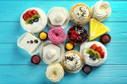 Assortment of tasty sweets on wooden background