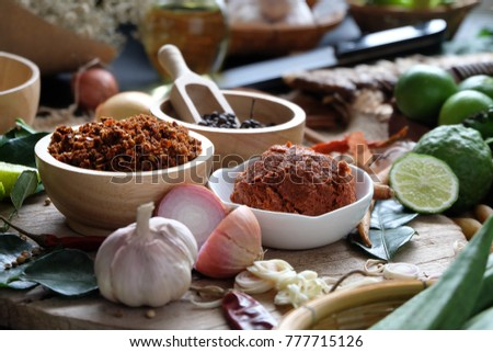 Assortment of Thai food Cooking ingredients. Spices ingredients chilli pepper garlicgalanga and kaffir lime leaves. #777715126