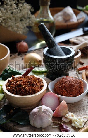 Assortment of Thai food Cooking ingredients. Spices ingredients chilli pepper garlicgalanga and kaffir lime leaves. #782673916