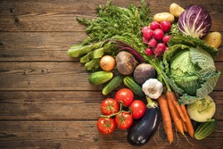 Assortment of the fresh vegetables on wooden background