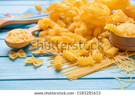 Assortment of uncooked pasta on table