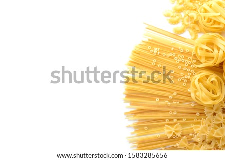 Assortment of uncooked pasta on white background