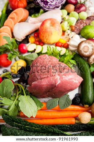 Assortment of Various Healthy Foods. Vegetables, Meats, Fruit, Oil, Nuts, Berries and Fish
