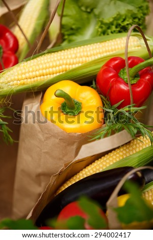 Assortment of vegetables organic food, fresh raw vegetables in bag grocery shop, shopping bags full of vegetables, harvest concept, organic corn, pepper,green salad, healthy eating, selective focus