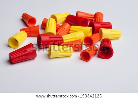 Assortment of wire connectors against a white surface