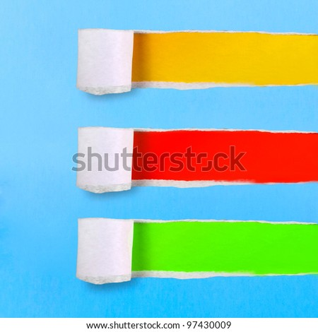 assortment torn of ripped blue green yellow red paper against colorful backgrounds