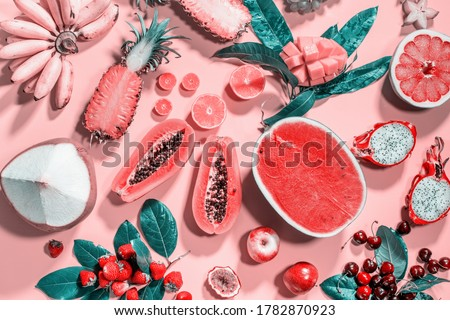 Assortment tropical exotic fruits berryes top veiw on pink background. Raw eating diet concept. Super natural food background. High resolution. Flat lay Stock photo ©