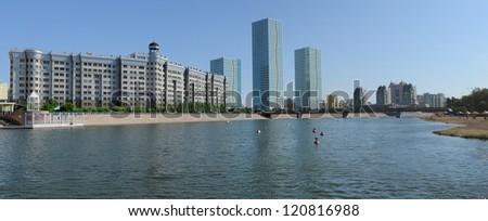 Astana Kazakhstan. Two modern skyscrapers at river bank.