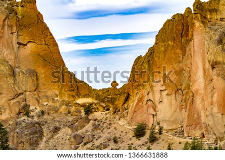 Asteristic rock against a blue and cloudy sky, Smith rock state park, Oregon, near Terrebonne #1366631888
