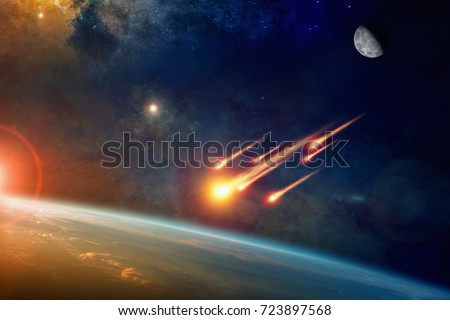 Stock Photo Asteroid impact, end of world, judgment day. Group of burning exploding asteroids from deep space approaches to planet Earth. Elements of this image furnished by NASA