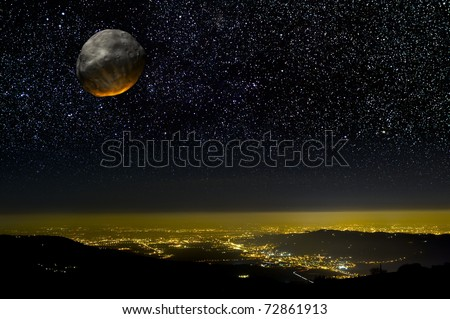 Asteroid impact over a city at night.