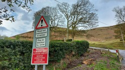 ASTERTON, SHROPSHIRE, UK - April 29 2021: Roadsign warning of potentially dangerous driving conditions on the Long Mynd in the Shropshire Hills