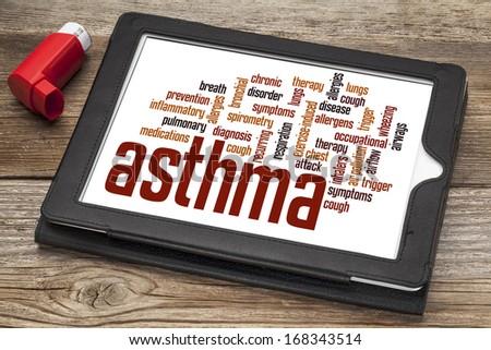 asthma word cloud on a digital tablet screen with an inhaler