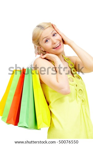 Astonished female with bags looking at camera in isolation