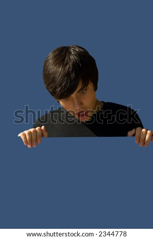 astonished young man holding a blank advert